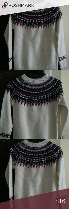 Brand New Knitted Sweater Thus sweater has never been worn and is in perfect condition with no rips or snags. The color is white with a red and blue pattern around the neck. It's without tags. The size is between extra small and small. Sweaters Crew & Scoop Necks