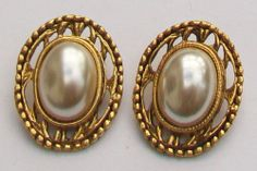 A pair of domed faux pearl cabochons in an ornate gold tone setting clip on earrings Measurement the earrings are approximately 3 cm Vintage Earrings, Clip On Earrings, Pearl Earrings, Vintage Wedding Jewelry, Vintage Clip, Brooch, Jewellery, Gold, Pearl Studs