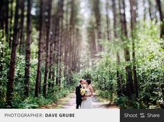 Love the amazing forest backdrop of this photo and how it frames the bride  groom. Great example of tilt shift photography. #wedding #brideandgroom #tiltshift #shootandshare  |  Photographer: Dave Grube  |  david-grube.com  |  Camera: Canon 5D Mark III  |  Lens: TS-E45mm f/2.8  |  Aperture: f/2.8  |  Exposure: 1/250  |  ISO: 200  |  Flash: No  |  Shoot and Share