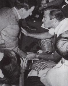 Holding a rosary given to him by the busboy, Juan Romero, Senator Robert Kennedy lies on the floor of the Ambassador Hotel after being shot June I had the privilege of talking to Rosey Grier, RFK's body guard about this incident.