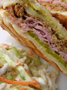 Cuban Sandwiches with Mojo Sauce.  Mojo Sauce  Recipe adapted from Serious Eats    8 cloves garlic, peeled  1/3 cup olive oil  1/3 cup orange juice  1/3 cup key lime juice and lemon juice, mixed  1/2 teaspoon cumin  1/2 teaspoon oregano  salt and pepper, to taste