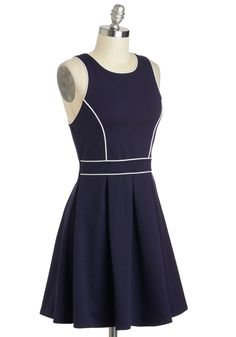 I love the white stripes on top of the Navy! (Drafting Table Dress at Mod Cloth.)