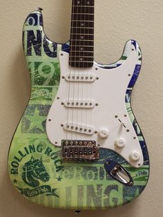 Custom wrapped Rolling Rock promotional guitar, by Brand O' Guitar Company.