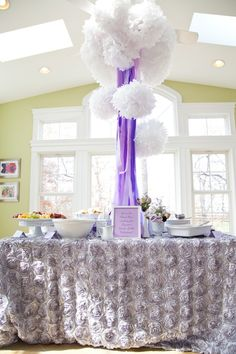 Love the tissue balls with the fabric hanging down on the food table. Great for a bridal shower or baby shower!