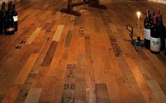 reclaimed wine-barrel flooring; cooperage, even. I love this idea.
