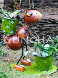 Ant with two pots!! This multi coloured planter, cute ant with two pots will definitely enhance the look of your garden area.