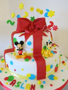 Mickey Mouse cake - like this, but wouldn't have the bow. Maybe trim each layer in red frosting and have characters on top?!?!