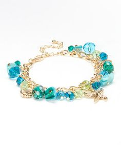 Another great find on #zulily! Turquoise & Gold Sea Life Charm Bracelet #zulilyfinds