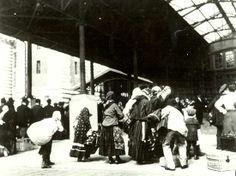 Immigrants arriving with baggage on Ellis Island, circa 1898.
