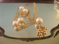 This wonderful vintage necklace, presented by JoysShop for consideration, is comprised of large 25mm simulated pearls accented with bright goldtone #filigree caps, chains an... #teamlove #voguet