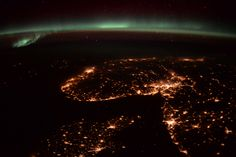 Denmark, Norway and Sweden under the aurora.  Denmark is at the bottom with Norway above it and Sweden to the right.  More about the Principia mission: www.esa.int/Principia  Credits: ESA/NASA  125H7262