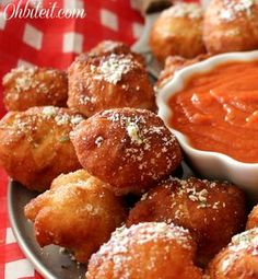 Fried Pizza Poppers - Pillsbury Pizza Dough (thin crust or regular), Pepperoni slices one per each popper, Mozzarella Cheese 1″ cubes one per each popper, Marinara Sauce for dipping, Oil for frying, Parmesan, Garlic Powder & Oregano for sprinkling.