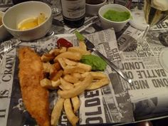 Fish, chips, peas, gravy, curry sauce, wine...what more could a host want to offer!