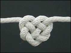 Celtic Rope tied into a knot.  Love this idea for tying the flowers together and everything we can lol