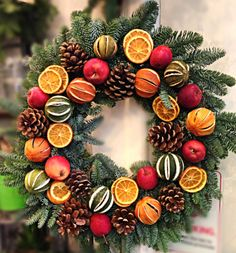 Wreath made up of - Oranges, Apples, Limes and cones