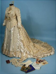 Dated October 5, 1880 Complete Beaded Victorian Wedding Gown Outfit with Original Wedding License and Invitations and Complete Accessories with Provenance!  Includes Shoes, Stockings, Gloves, Photos, Books, Papers, Silver Spoon, Wax Headpiece, Wax Ornaments, and Large Framed Portrait of the Bride, Corrie Emma Lacy who wedded Dr. Lee Herbert Smith in Buffalo, New York.