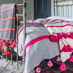 http://www.grahamandgreen.co.uk/sabah-orange-stripe-pom-rug