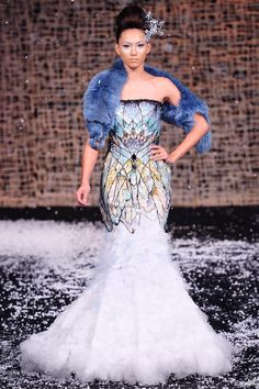~Not sure about the blue fur, but the dress is stunning!~ Michael Cinco 2011/2010