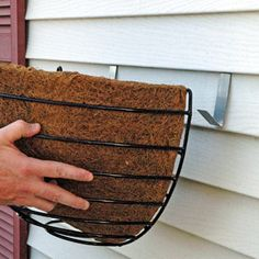 Vinyl siding hooks to use with a wall planter & liner..... FINALLY I can have flowers outside my window this year!