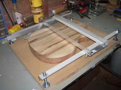Router Planing Jig by ArieBombarie -- Homemade router planing jig intended for guitar bodies. Constructed from aluminum angle, MDF, and hardware. http://www.homemadetools.net/homemade-router-planing-jig-10
