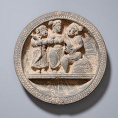 DECORATIVE PLATE WITH DIVINITYCatalog Number: VS0617-208Gray schistGandharaAncient Gandhara culture, 1st to 2nd cent.DIAMETER 13,8 CM
