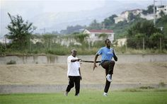 Bolt training with his coach