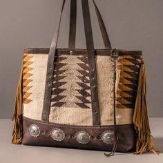 Fringed Navajo tote with 4 antique sterling and turquoise conchos