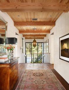window wall wide open hallway with oriental rug on wood plank floor