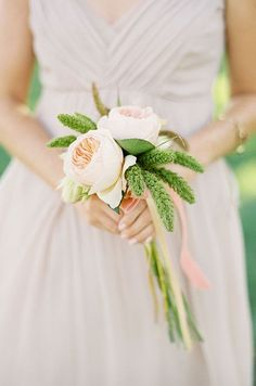 A simple and romantic wedding bouquet compliments the delicate dusty rose colored bridesmaid dress