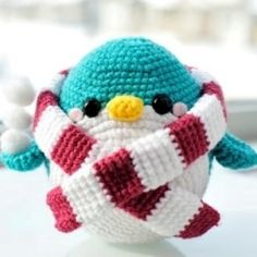 Crochet this friendly amigurumi penguin complete with removable scarf, perfect for any season of the year!