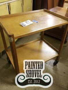 Rolling serving cart sold by auction at Painted Shovel in Avondale, AL.