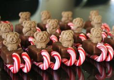 Mini Milky Ways, mini Candy Canes, Tiny Teddies and a little bit of melted chocolate. Use the melted chocolate to glue the Candy Canes to the bottom of the Milky Ways, allow to set. Turn over and gently squish the tiny teddy in the top, via a broken link wish I knew who get's credit for this cute idea.