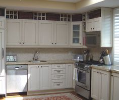 Ideas for space above kitchen cabinets. wicker basket storage and compartments for non-often-used items. Also, maybe a couple of glass doors and lights for display pieces?