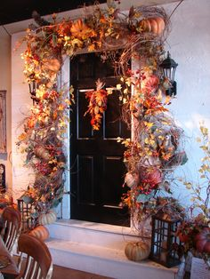 Layer honeysuckle around your entry with pumpkins, stems, ribbon and more for a festive look! www.thewhitehare.com