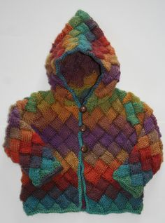 Ravelry: Apple of my Eye Baby Sweater pattern by Carol Wells in Crystal Palace 105 Tapestry Rainbow by Crystal Palace Yarns