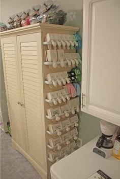 "It's Written on the Wall: Craft Room Organizing-Store over 200 Rolls of Ribbon in a 12"" square Space!"