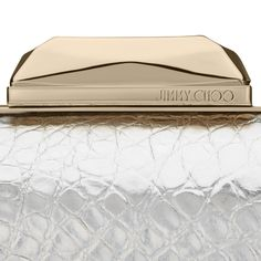 Close up details of the Jimmy Choo CLOUD clutch in silver and gold metallic textures