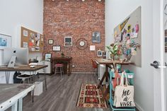 love: that brick wall!!!//Jeanetta & Brian's Incredible Shared Space Creative Workspace Tour | Apartment Therapy