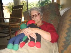 Mom resting with SMAC! Monkeys NoMo and Phoenix. I hate cancer.