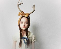 Because I wasn't enough of an outcast as a child. Why, oh why did my mother not adorn me with antlers. they do all kind of wierd stuff...