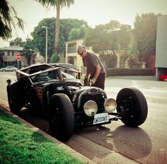 I dig the geometric slanted windshield and roof of this rat rod