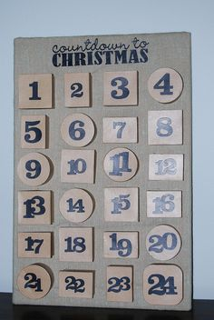 Advent Calendar boxes instead of the envelopes - love this idea! This blog uses a cork board but I'm sure anything would do to just attach the boxes to.
