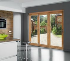 Bi-Fold Doors Melbourne - AMJ Bi-Fold Doors & Bifold Patio Doors fold and open in its middle part. They have been ...
