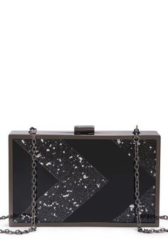Night Vision is an opulent cocktail clutch that is the epitome of modern, holiday glam.
