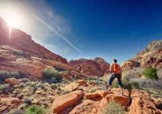 Man Looking At Sun Whilst Hiking At Red Rock Man