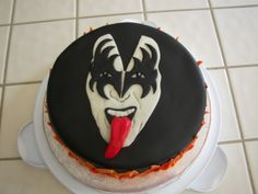 Gene Simmons KISS Cake - Red Velvet cake w/cream cheese frosting and filling.  Everything else is fondant.  Added glycerin to red fondant while kneeding/forming to make tongue shiny.