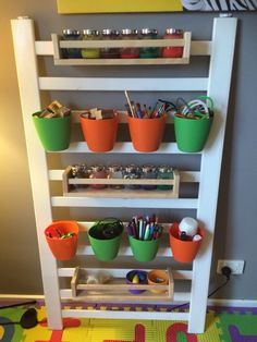 Upcycled cot/crib side into a craft centre.