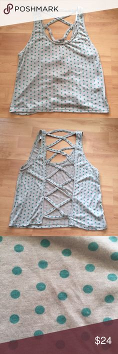Polka dot tank with crossed back detail NWOT Casual tank top with polka dot print and open back with criss crossed detail. Never worn so in perfect condition. Lucca Couture Tops Tank Tops
