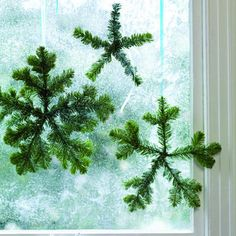 Snowflakes in window: a crafty alternative to the traditional wreath.