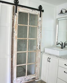 (@operationprettyhouse) on Instagram: antique barn door. Barn door hardware. White cabinets. White bathroom. Pretty bathroom. White decor. Neutral decor. Farmhouse style. Traditional style.